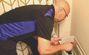 a man fixing a toilet