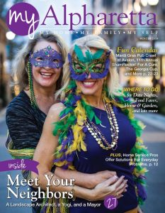 Two ladies dressed for Mardi Gras Pub Crawl at Avalon