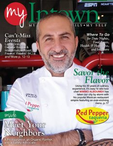 Mimmo Alboumeh in his chef coat smiles with folded arms