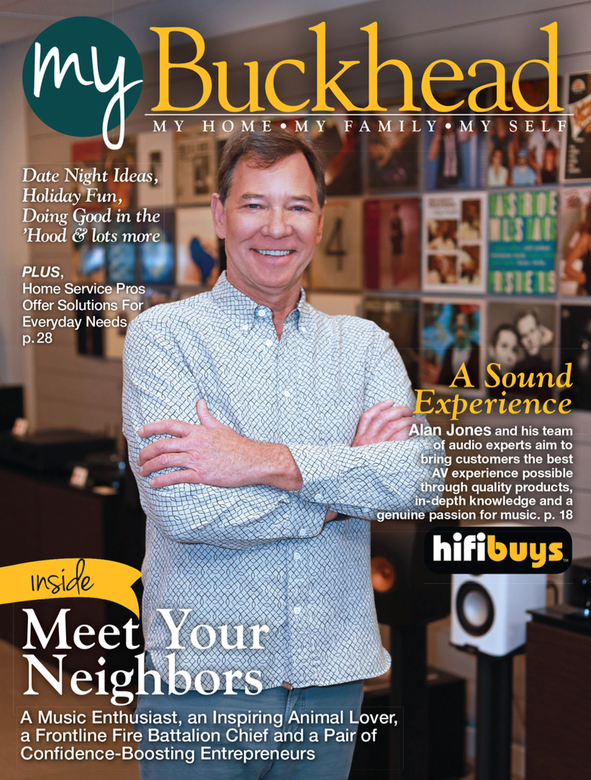 Cover of My Buckhead magazine with man standing in front of records on wall