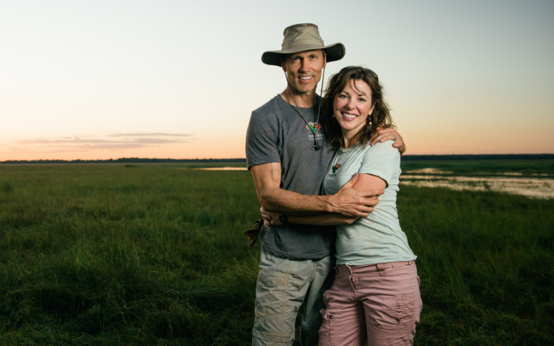 Michele Stumpe and husband standing in front of african safari