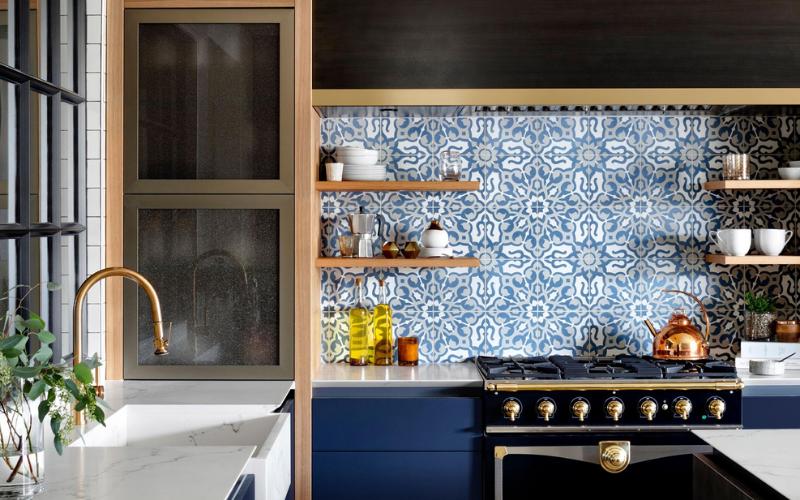 Intricate blue tile backsplash in a traditional kitchen
