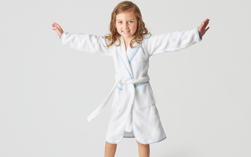 little girl in robe