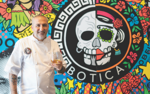 Chef mimmo standing in front of Botica mural