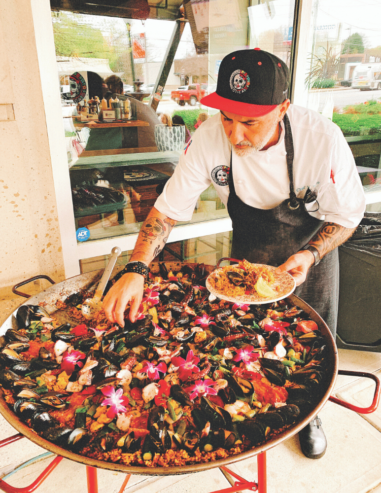 Chef Mimmo cooks paella on the patio every Wednesday.