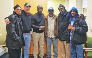 Veterans and volunteers standing together