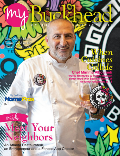 Chef Mimmo in front of a colorful mural on the cover of My Buckhead