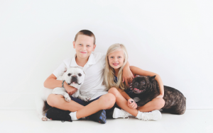 two kids with dogs