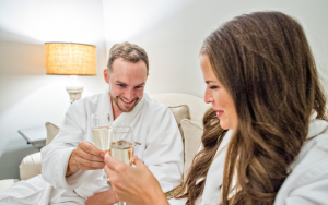 two people holding champagne