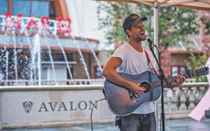 guy playing guitar and singing