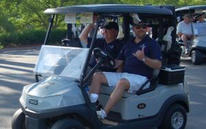 2 men on a gold cart